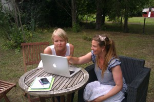 Emilia (left) and Malin (right) busy at work in Oleg's garden in Uppsala